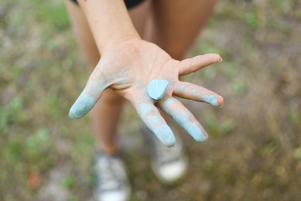 toddler showing blue chalk on hand